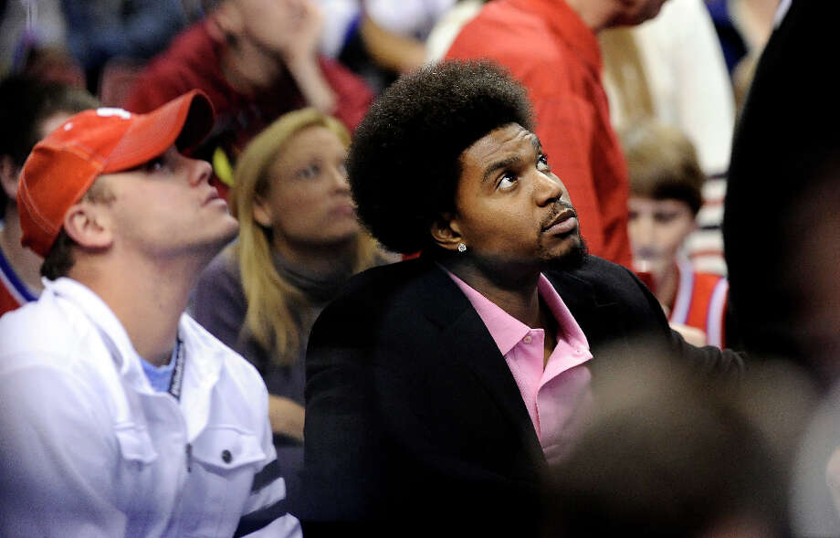Philadelphia 76ers Andrew Bynum is seen on the bench during the second  half of an NBA basketball game, Sunday, Nov. 18, 2012, in Philadelphia. The 76ers won, 86-79. Photo: Michael Perez, Associated Press / FR168006 AP