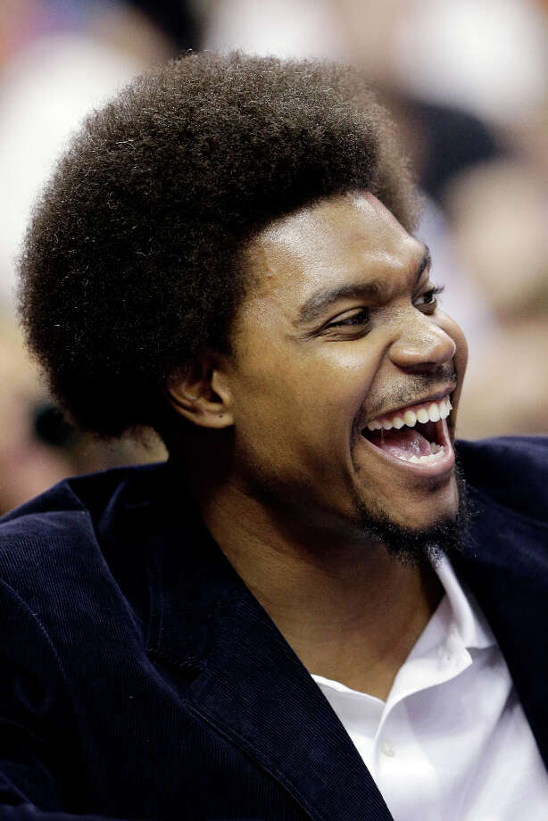 Injured Philadelphia 76ers center Andrew Bynum laughs with teammates while sitting the bench in the second half of an NBA basketball game against the Utah Jazz, Friday, Nov. 16, 2012, in Philadelphia. Philadelphia won 99-93. Photo: Matt Slocum, Associated Press / AP