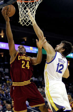 Cleveland Cavaliers forward Samardo Samuels (24) shoots against Golden State Warriors center Andrew Bogut (12), from Australia, during the first quarter of an NBA basketball game in Oakland, Calif., Wednesday, Nov. 7, 2012. Photo: Jeff Chiu, Associated Press / AP