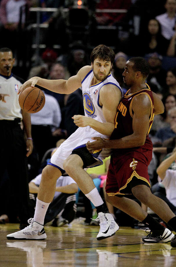 Golden State Warriors center Andrew Bogut (12), from Australia, against power forward Samardo Samuels (24) during the first half of an NBA basketball game in Oakland, Calif., Wednesday, Nov. 7, 2012. Photo: Jeff Chiu, Associated Press / AP