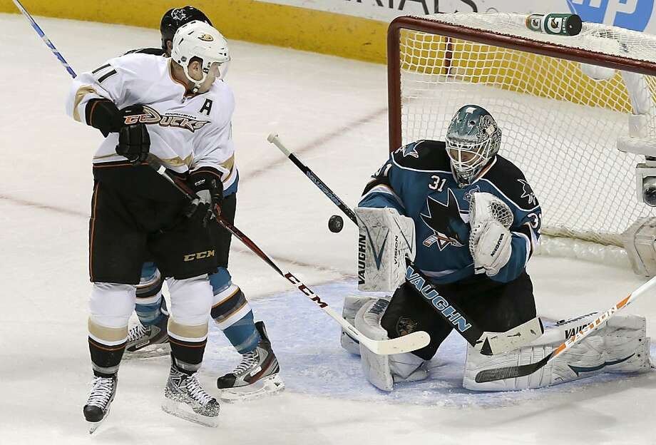 Sharks goalie Antti Niemi blocks a shot by Anaheim's Saku Koivu. Niemi made 28 saves. Photo: Jeff Chiu, Associated Press