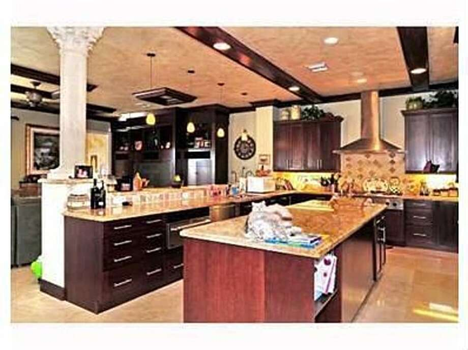 Swanky kitchen for a squatter. All photos via Zillow