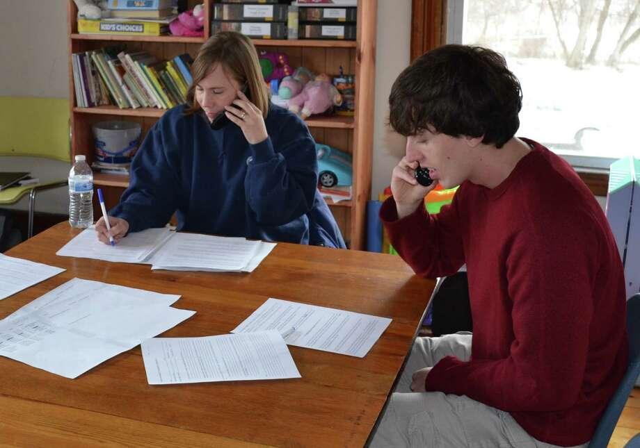 Volunteers conduct survey calls