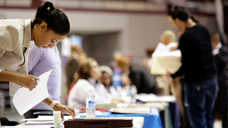 Shannon Lee, left, recruiter for Randstad staffing, organizes her received resumes, during a job fair, Monday, September 10, 2012 at the M.O. Campbell center in Houston, Texas. Photo: TODD SPOTH, . / Todd Spoth