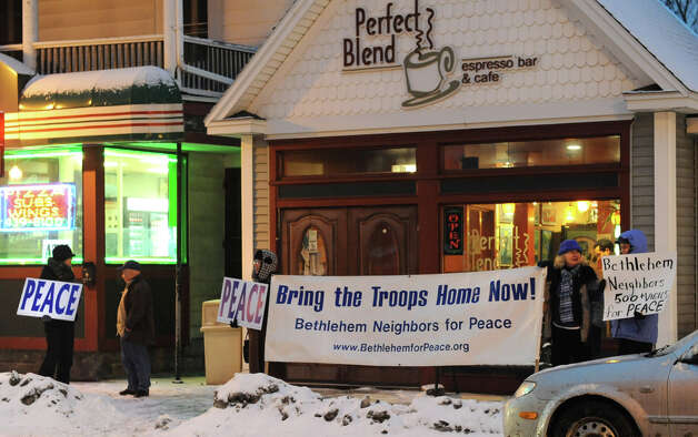 Bethlehem Neighbors participate in a vigil that commemorates over 500 peace vigils held at the Four Corner since 2003 on Monday Jan. 28, 2013 in Delmar, N.Y.  (Lori Van Buren / Times Union) Photo: Lori Van Buren