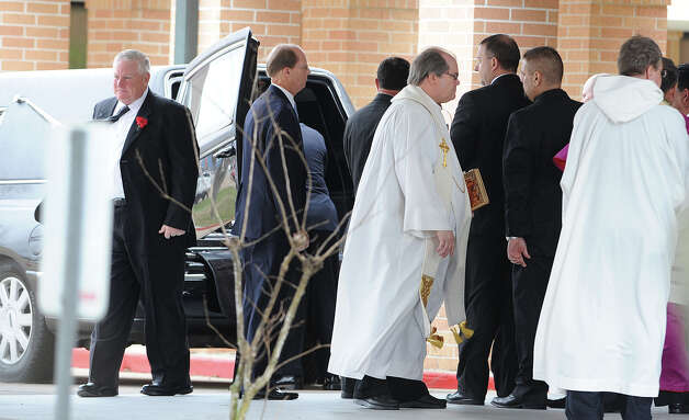 Victor Lovelady's casket is placed in a hearse after services at St. Charles Catholic Church on Tuesday. Lovelady was recently killed after a terrorist attack at an Algerian gas plant where he worked.  Photo taken Tuesday, January 29, 2013 Guiseppe Barranco/The Enterprise Photo: Guiseppe Barranco, STAFF PHOTOGRAPHER / The Beaumont Enterprise