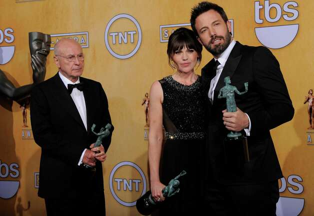 From left: Actors Alan Arkin, Clea Duvall and Ben Affleck pose backstage with the award for best cast in a motion picture at the 19th Annual Screen Actors Guild Awards at the Shrine Auditorium in Los Angeles on Sunday Jan. 27, 2013. (Photo by Chris Pizzello/Invision/AP) Photo: AP