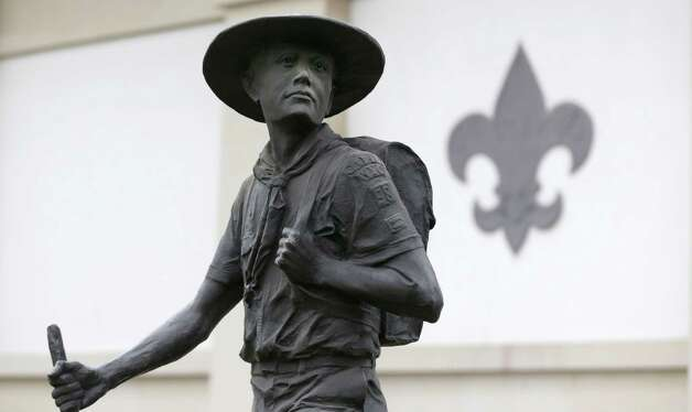 A statue of a Boy Scout stands in front of the National Scouting Museum, Monday, Jan. 28, 2013, in Irving, Texas. The Boy Scouts of America announced it is considering a dramatic retreat from its controversial policy of excluding gays as leaders and youth members. Photo: LM Otero