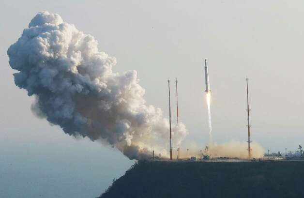 South Korea's rocket lifts off from its launch pad at the Naro Space Center in Goheung, South Korea, Wednesday, Jan. 30, 2013. South Korea says it has successfully launched a satellite into orbit from its own soil for the first time. Wednesday's high-stakes launch comes just weeks after archrival North Korea successfully launched its own satellite to the surprise of the world.  KOREA OUT Photo: Yonhap, Lee Sang-hak