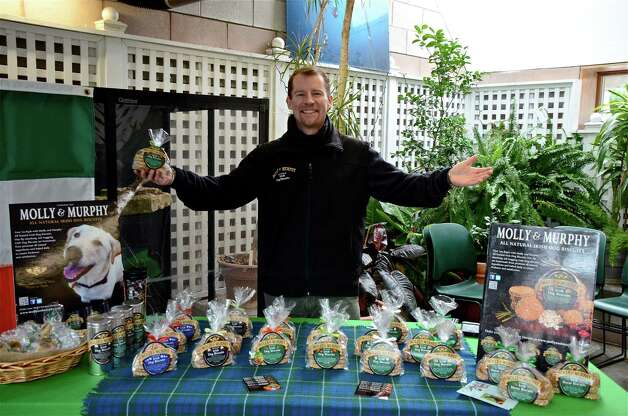Chris Hamilton, owner of Molly & Murphy All Natural Irish Dog biscuits, shows off his wares at the New Canaan Farmers Market at the New Canaan Nature Center Tuesday, Jan. 29, 2012. Photo by Jeanna Petersen Shepard / For the New Canaan News Photo: Contributed Photo