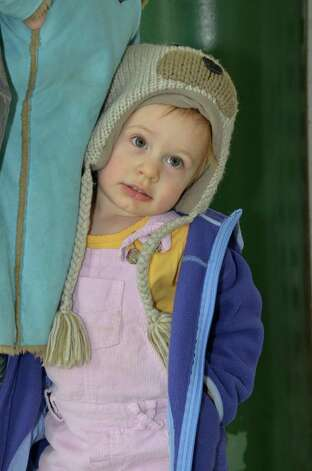 Clare O'Brian, 3, awaits her pickles at the New Canaan Farmers Market at the New Canaan Nature Center, Tuesday, Jan. 29, 2012. Jeanna Petersen Shepard / For the New Canaan News Photo: Contributed Photo