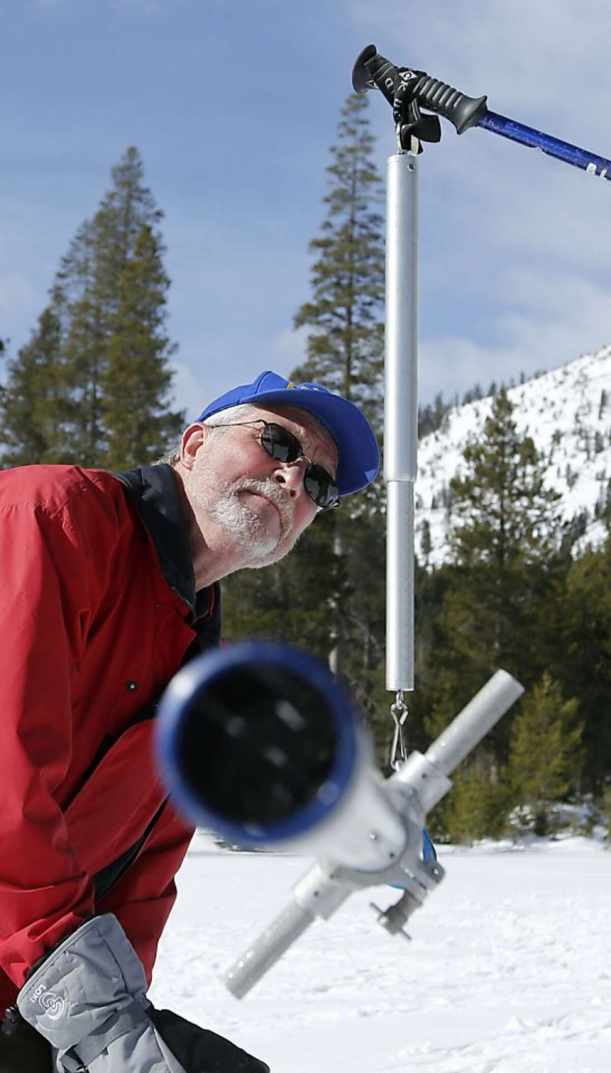 Frank Gehrke, chief of snow surveys for the Department of Water Resources, checks the weight of the snowpack survey tube as he conducts the second snow survey of the year at Echo Summit, Calif., Tuesday, Jan. 29, 2013. Surveyors have confirmed what many feared after a relatively dry January - the water content of snow that has accumulated in the Sierra is slightly below average for this time of year. (AP Photo/Rich Pedroncelli)