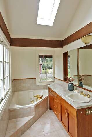 A Jacuzzi tub is a prominent feature of the master bathroom. Photo: Liz Rusby