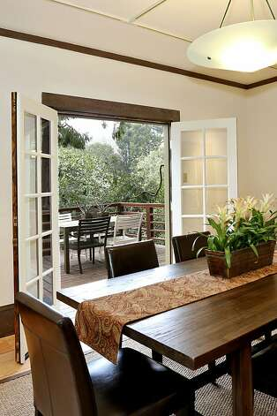 French doors and hardwood floors are features of the formal dining room. Photo: Liz Rusby