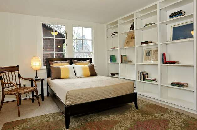 The four-bedroom home has built-in bookshelves in several bedrooms. Photo: Liz Rusby