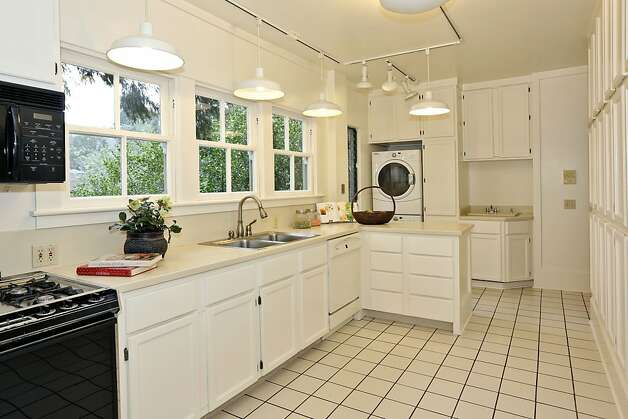 The kitchen of the four-bedroom home also has a laundry area. Photo: Liz Rusby