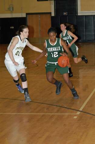 Emma Oyomba is defended by Kristina Vetter during the Bears' loss to Trumbull Tuesday night. Photo: Andy Hutchison