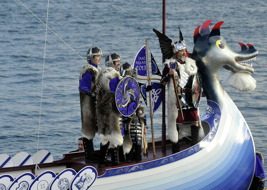 Participants dressed as Vikings pose on their longboat during the annual Up Helly Aa festival in Lerwick, Shetland Islands on January 29, 2013. Up Helly Aa celebrates the influence of the Scandinavian Vikings in the Shetland Islands and culminates with up to 1,000 'guizers' (men in costume) throwing flaming torches into their Viking longboat and setting it alight later in the evening. Photo: AFP, AFP/Getty Images / 2013 AFP