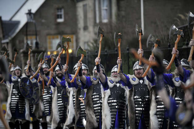 Participants dressed as Vikings march past during the annual Up Helly Aa festival in Lerwick, Shetland Islands on January 29, 2013. Up Helly Aa celebrates the influence of the Scandinavian Vikings in the Shetland Islands and culminates with up to 1,000 'guizers' (men in costume) throwing flaming torches into their Viking longboat and setting it alight later in the evening. Photo: AFP, AFP/Getty Images / 2013 AFP