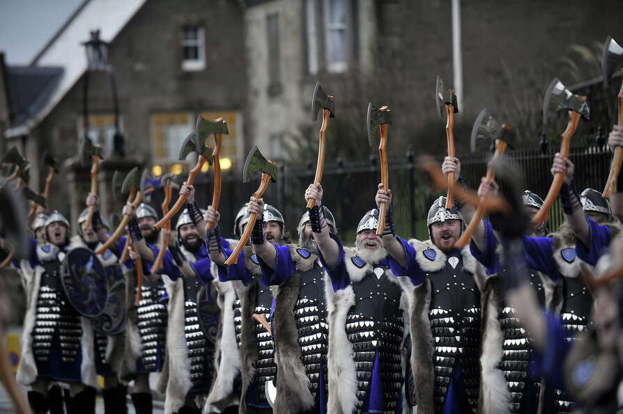 Participants dressed as Vikings march past during the annual Up Helly Aa festival in Lerwick, Shetla