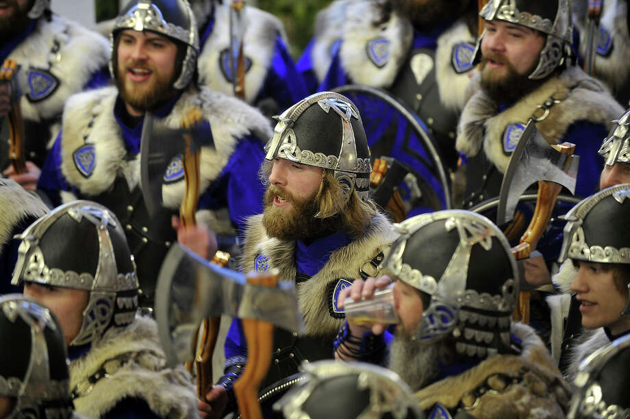 Participants dressed as Vikings prepare to participate in the annual Up Helly Aa festival in Lerwick, Shetland Islands on January 29, 2013. Up Helly Aa celebrates the influence of the Scandinavian Vikings in the Shetland Islands and culminates with up to 1,000 'guizers' (men in costume) throwing flaming torches into their Viking longboat and setting it alight later in the evening. Photo: AFP, AFP/Getty Images / 2013 AFP