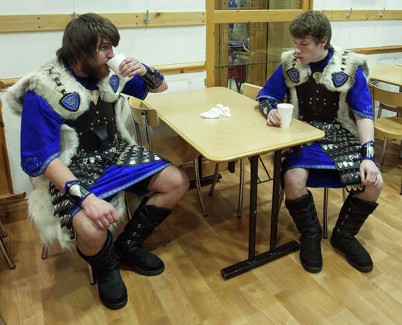 Participants dressed as Vikings enjoy as hot drink as they prepare to participate in the annual Up Helly Aa festival in Lerwick, Shetland Islands on January 29, 2013. Up Helly Aa celebrates the influence of the Scandinavian Vikings in the Shetland Islands and culminates with up to 1,000 'guizers' (men in costume) throwing flaming torches into their Viking longboat and setting it alight later in the evening. Photo: AFP, AFP/Getty Images / 2013 AFP