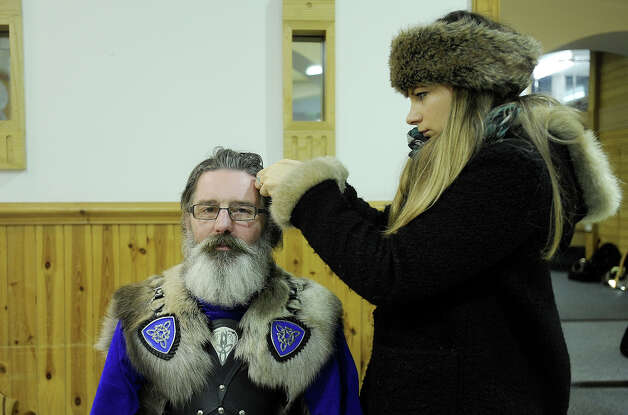 A participant dressed as a Viking has his hair braided as he prepares to participate in the annual Up Helly Aa festival in Lerwick, Shetland Islands on January 29, 2013. Up Helly Aa celebrates the influence of the Scandinavian Vikings in the Shetland Islands and culminates with up to 1,000 'guizers' (men in costume) throwing flaming torches into their Viking longboat and setting it alight later in the evening. Photo: AFP, AFP/Getty Images / 2013 AFP