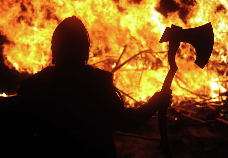 Members of the 2013 'Jarl Squad' prepare for the annual Up Helly Aa festival which culminates in the burning of a Viking Galley in Lerwick, Shetland Islands on January 29, 2013. Up Helly Aa celebrates the influence of the Scandinavian Vikings in the Shetland Islands and culminates with up to 1,000 'guizers' (men in costume) throwing flaming torches into their Viking longboat and setting it alight later in the evening. Photo: AFP, AFP/Getty Images / 2013 AFP