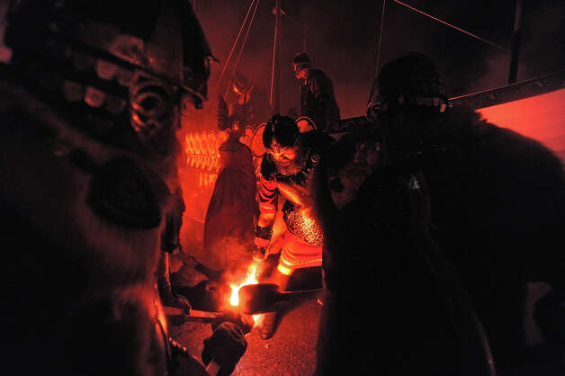 Members of the 2013 'Jarl Squad' take part in the annual Up Helly Aa festival which culminates in the burning of a Viking Galley in Lerwick, Shetland Islands on January 29, 2013. Up Helly Aa celebrates the influence of the Scandinavian Vikings in the Shetland Islands and has employed this theme in the festival since 1870. The event culminates with up to 1,000 'guizers' (men in costume) throwing flaming torches into their Viking longboat. Photo: AFP, AFP/Getty Images / 2013 AFP