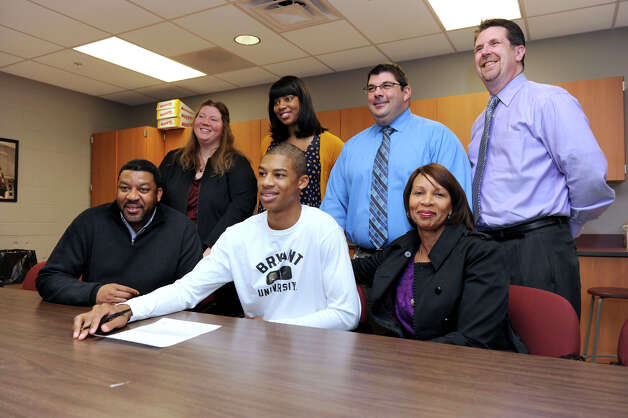 Daniel Garvin, 17, a Bethel High School basketball star, center, has signed a Letter of Intent to play Division I at Bryant University next year. There was a small ceremony for him at the high school Wednesday, January 30, 2013. Photo: Carol Kaliff / The News-Times