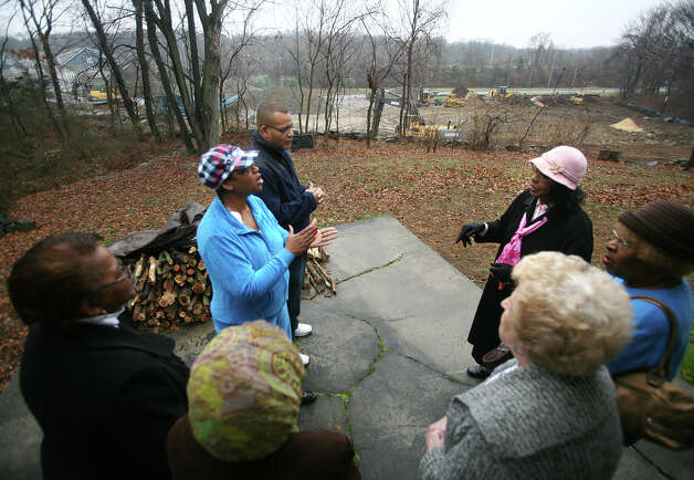 Rose Meekins, in plaid hat, and her neighbors gather behind her 45 Iwanicki Circle home in Bridgeport to discuss their plans to stop construction of a shopping center on the adjoining Huntington Turnpike property. On January 30, 2013, Superior Court Judge Richard Gilardi refused a city request to block further construction on a three and a half-acre site on Huntington Turnpike where developer Manuel Moutinho plans to put up a 19,500 square foot shopping center. Photo: Brian A. Pounds / Connecticut Post