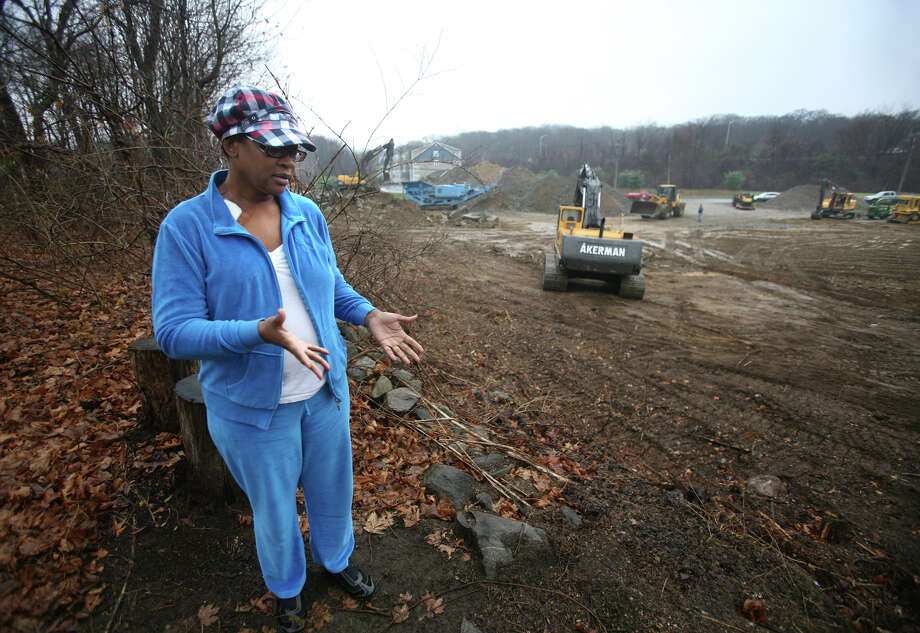 Rose Meekins is irate about the construction of a Huntington Turnpike shopping center that abuts the backyard of her 45 Iwanicki Circle home in Bridgeport. On January 30, 2013, Superior Court Judge Richard Gilardi refused a city request to block further construction on a three and a half-acre site on Huntington Turnpike where developer Manuel Moutinho plans to put up a 19,500 square foot shopping center. Photo: Brian A. Pounds / Connecticut Post