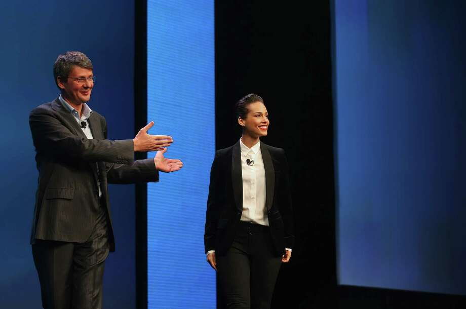 NEW YORK, NY - JANUARY 30:  BlackBerry President and Chief Executive Officer Thorsten Heins (L) introduces new BlackBerry Global Creative Director Alicia Keys at the BlackBerry 10 launch event at Pier 36 in Manhattan on January 30, 2013 in New York City. The new smartphone and mobile operating system is being launched simultaneously in six cities. Photo: Mario Tama, Getty Images / 2013 Getty Images