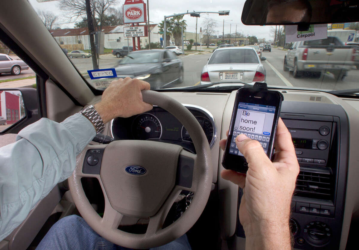 Photo illustration on texting while driving Tuesday, Jan. 29, 2013, in Houston.