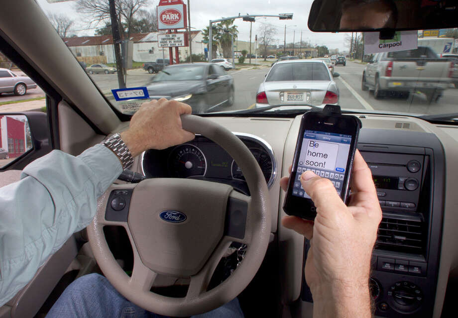 Photo illustration on texting while driving Tuesday, Jan. 29, 2013, in Houston. Photo: Cody Duty, Cody Duty / Houston Chronicle / © 2013 Houston Chronicle