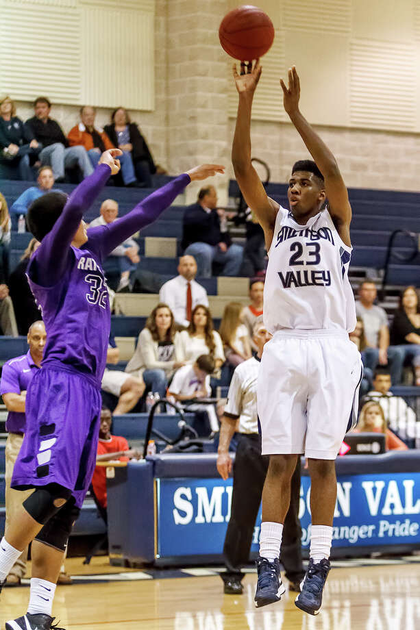 Smithson Valley's A.C. Reid (right) puts up a shot over San Marcos's Isaiah Brown during the first half of their game at Smithson Valley on Jan. 29, 2013.  Reid scored 36 for the Rangers though San Marcos came away with a 78-77 victory.  Photo by Marvin Pfeiffer / Prime Time Newspapers Photo: MARVIN PFEIFFER, Marvin Pfeiffer / Prime Time New / Prime Time Newspapers 2013