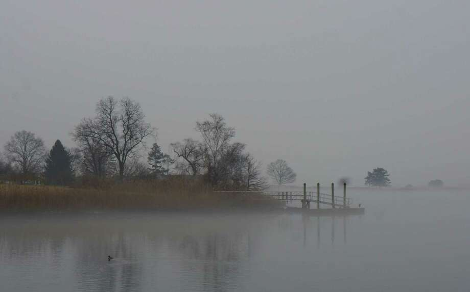 The fog was slow to lift, shrouding Southport Harbor in a thick veil Wednesday morning. Photo: Genevieve Reilly / Fairfield Citizen
