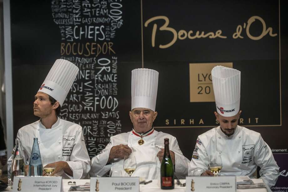 Judges Rasmus Kofoed (L), Paul Bocuse (C) and Enrico Crippa (R) taste candidates' recipes during the 14th world final of the international culinary competition of the Bocuse d'Or