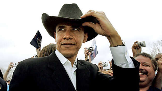 President Barack Obama wears a cowboy hat. Photo: .