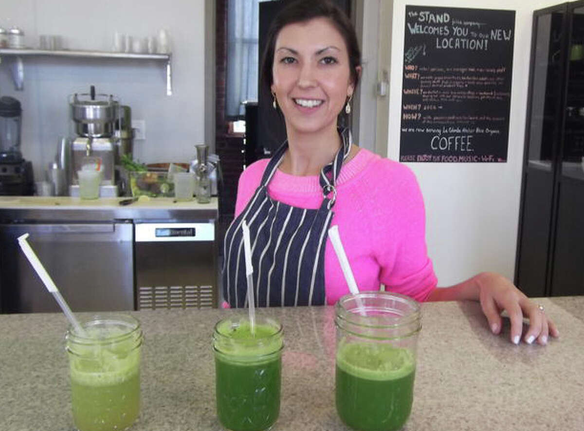 """Carissa Hvizdo, owner of The Stand in Fairfield, is passionate about the health benefits of """"green"""" juices."""