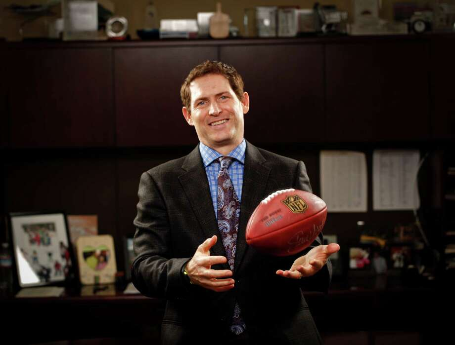 Steve Young, former Super Bowl-winning quarterback for the San Francisco 49ers is seen in his office at Huntsman Gay Global Capital where he is a managing partner on Monday, Jan. 28, 2013 in Palo Alto, Calif. Photo: Russell Yip/San Francisco Chroni / Greenwich Time Contributed Russell Yip/San Francisco Chronicle