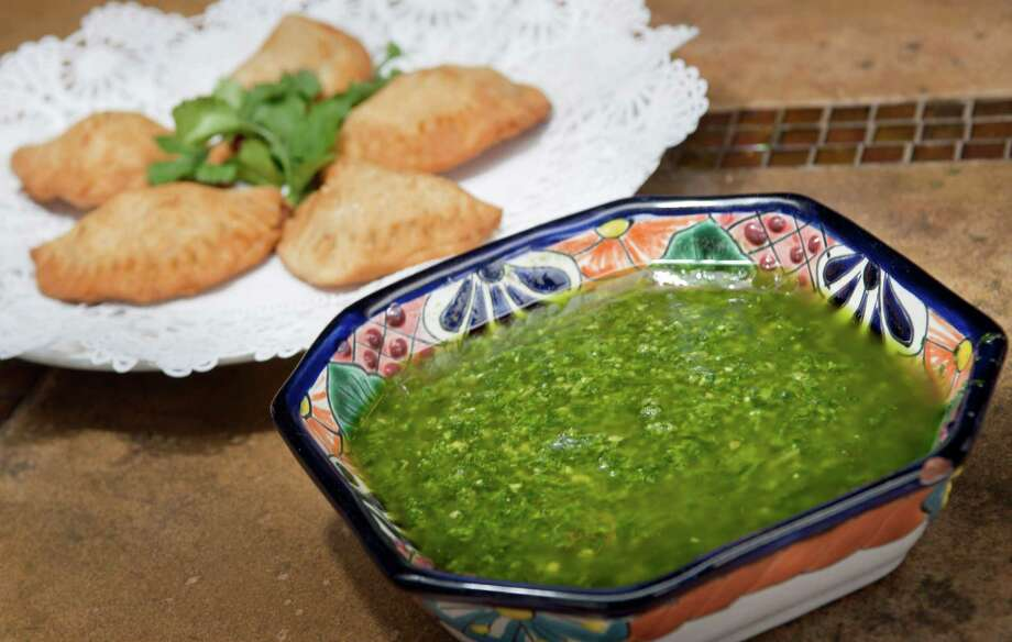 The Cilantro Pesto at El Jarro de Arturo perks up everything from grilled shrimp, steak or chicken to roasted potatoes, pasta or the restaurant's scrumptious empanadas. Photo: Darren Abate, Darren Abate/For The Express-New