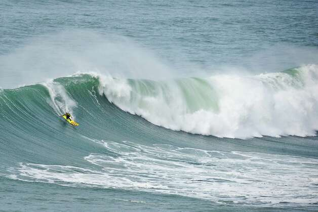 US surfer Garrett McNamara rides a wave during a surf session at Praia do Norte in Nazare on Wednesday. (PATRICIA DE MELO MOREIRA/AFP/Getty Images) Photo: PATRICIA DE MELO MOREIRA, Ap/getty / 2013 AFP
