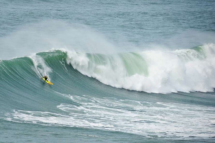 US surfer Garrett McNamara rides a wave during a surf session at Praia do Norte in Nazare on Wednesd