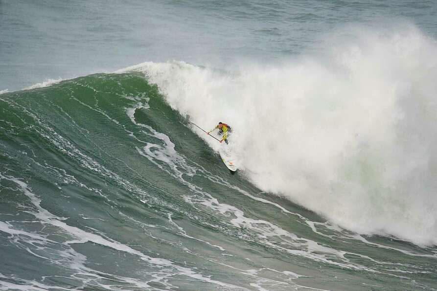 Garrett McNamara rides a wave during a surf session at Praia do Norte in Nazare on Wednesday. (PAT