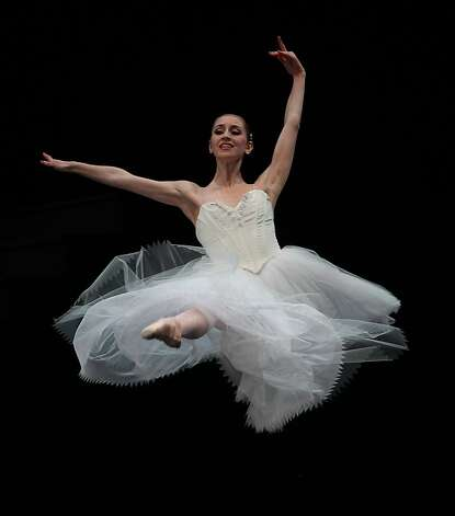 "SF Ballet dancers practice during a dress rehearsal of ""Suite en Blanc"" at the War Memorial Opera House in San Francisco, Calif.,  on Tuesday, January 29, 2013. Photo: Liz Hafalia, The Chronicle"