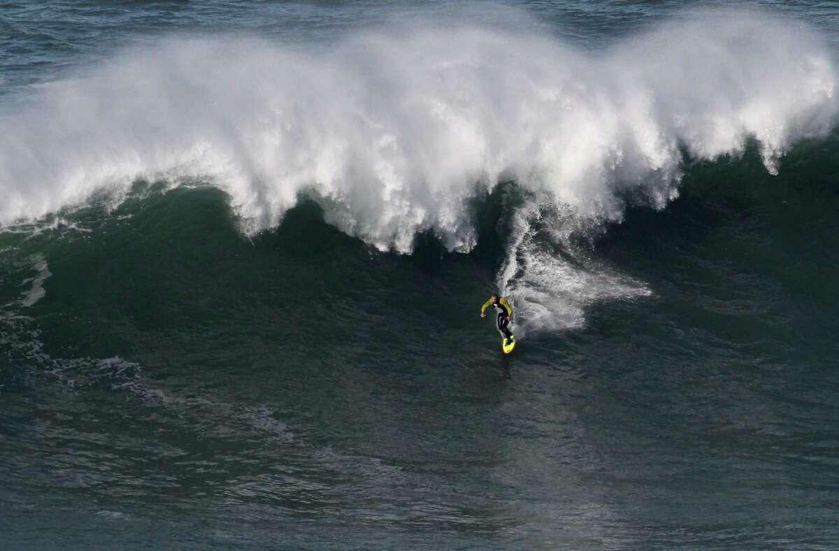 Garrett McNamara rides a wave at Praia do Norte beach in Nazare, Portugal, on Tuesday. (AP Photo/Francisco Seco)