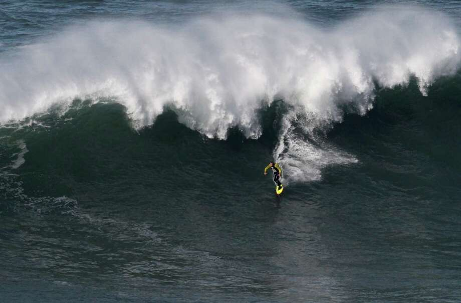 Garrett McNamara rides a wave at Praia do Norte beach in Nazare, Portugal, on Tuesday. (AP Photo/Francisco Seco) Photo: Ap/getty