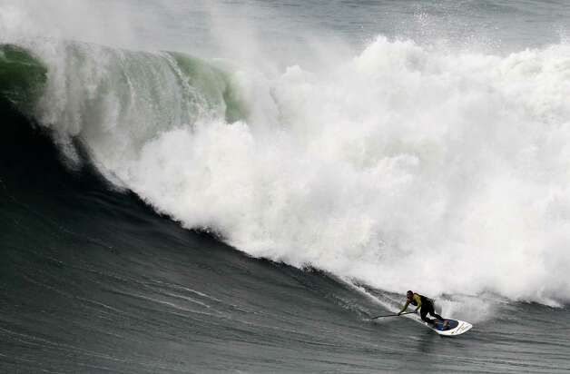 Garrett McNanamara rides a wave during a surf session at Praia do Norte beach in Nazare, Portugal, on Wednesday.  (AP Photo/Francisco Seco) Photo: Ap/getty