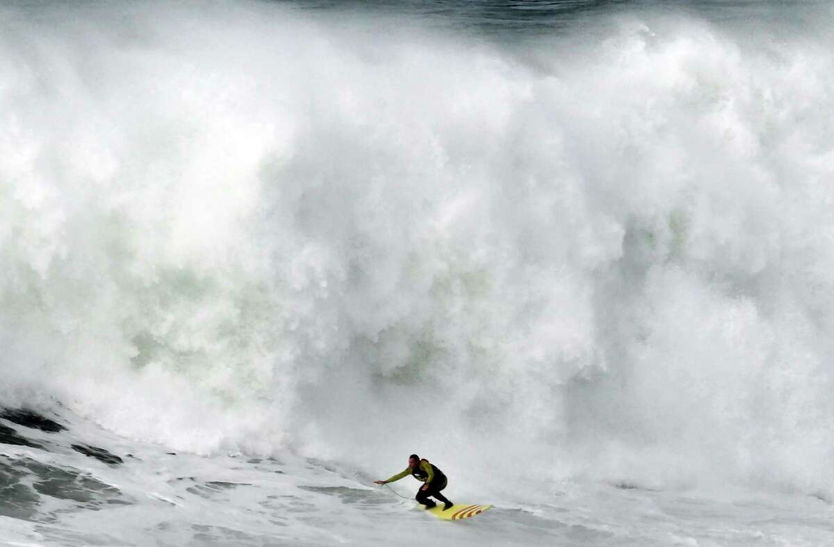 Garrett McNanamara rides a wave during a surf session at Praia do Norte beach in Nazare, Portugal, on Wednesday. (AP Photo/Francisco Seco)
